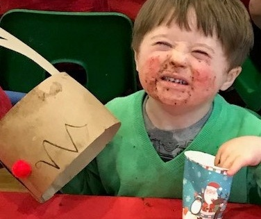 Jake Willmott enjoying his chocolate cake!